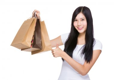 Asian shopping woman with thumb up stock vector