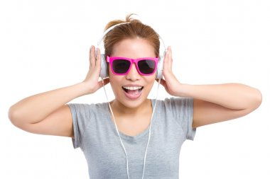 Woman with headphone and sunglasses