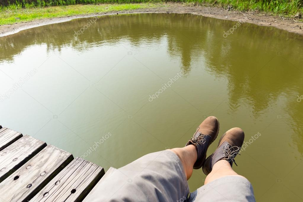 Man's legs with lake