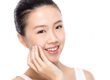 Asian woman with toothy smile