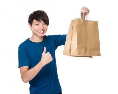 Man with shopping bags and thumb up