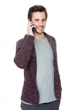 Handsome man in knitted cardigan talk on mobile phone stock vector