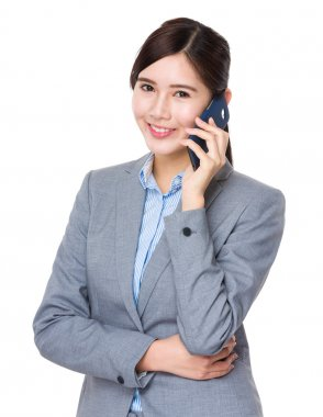 Asian businesswoman in business suit chat on cellphone stock vector