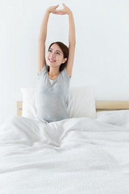 asian woman waking up and stretching