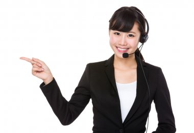 businesswoman with headset and finger pointing aside
