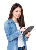 Asian young woman using the digital tablet