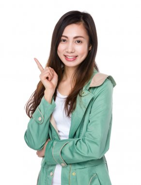 Asian young woman in green coat