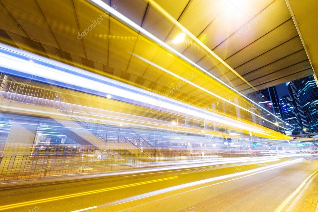 Фотообои Fast moving car at night in modern city
