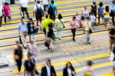 people on zebra crossing busy street