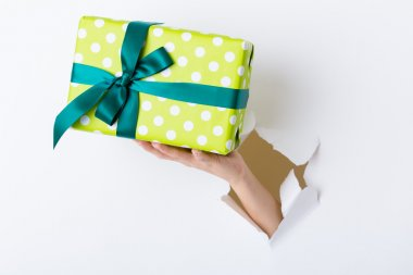 Hand with green present box