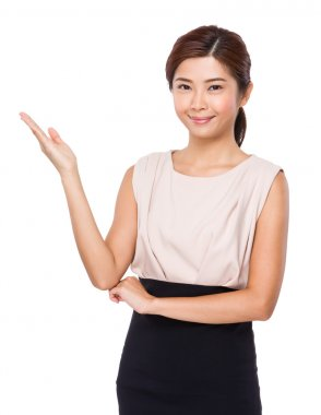 Young asian woman in beige dress with open hand palm stock vector