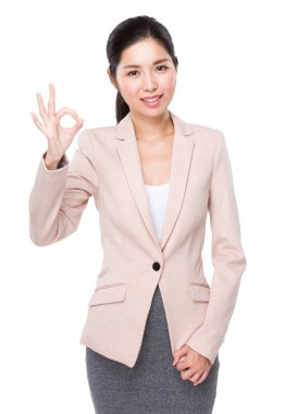 Young asian businesswoman in business suit with ok sign gesture stock vector
