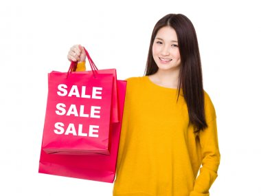 Asian young woman with shopping bag