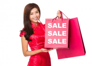Chinese Woman holding   paper bags with sale words stock vector