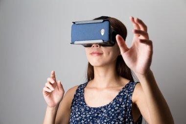 Woman using the virtual reality device