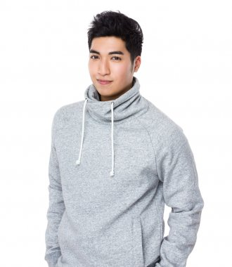 Asian young man in grey hoodie