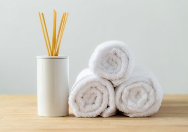 Scented sticks and white towels