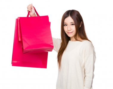 Asian young woman in beige sweater