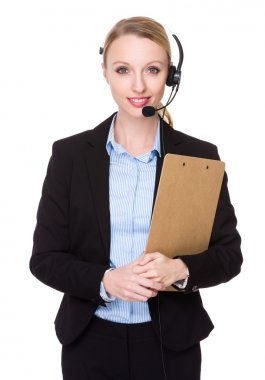 Caucasian female customer services representative with headset and clipboard stock vector