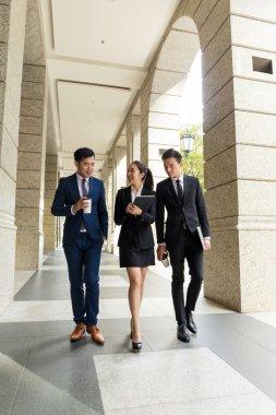 business people walking outside office