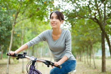 Woman enjoy riding a bike