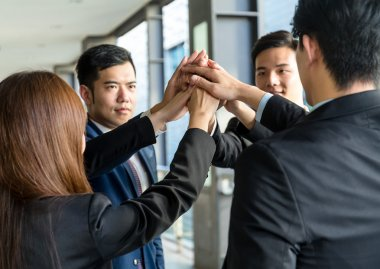 business people joining hands together