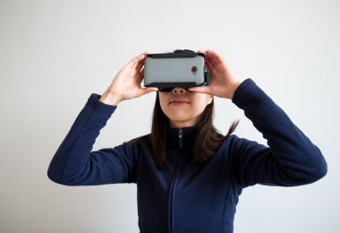 woman using virtual reality device