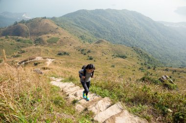 Asian woman hiker climb mountain