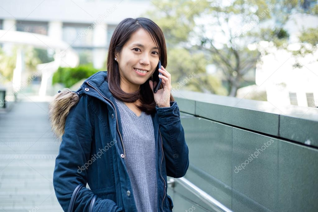 Asian girl talking on phone