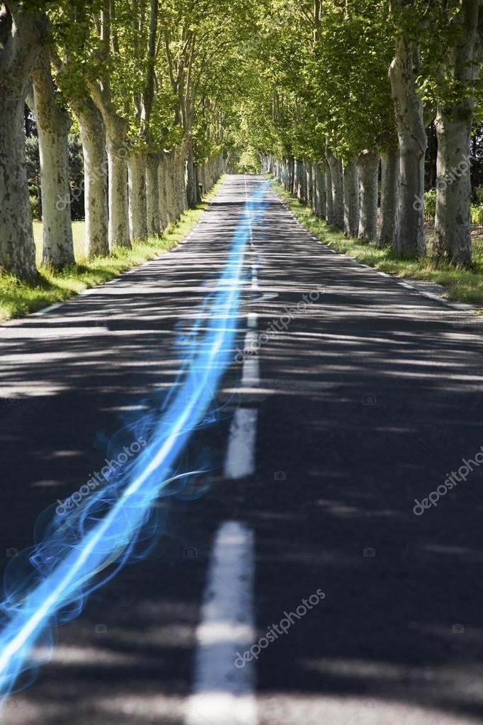 Streak of light on country road