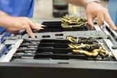 Photo technician examining computer card slots