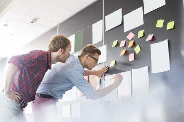 Businessmen analyzing documents