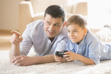 Father and son playing video game