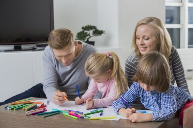 Parents with children drawing