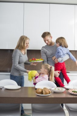 Family with children having meal