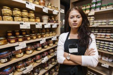 Confident saleswoman standing