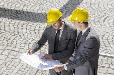 Architects examining blueprint