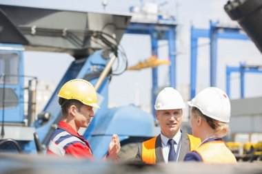 Workers discussing