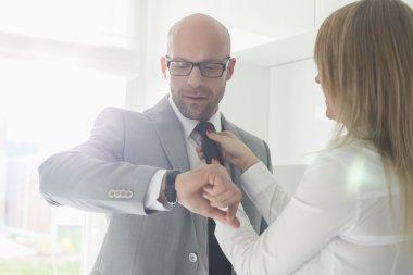 businessman checking wristwatch