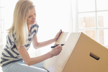 Woman labeling moving box