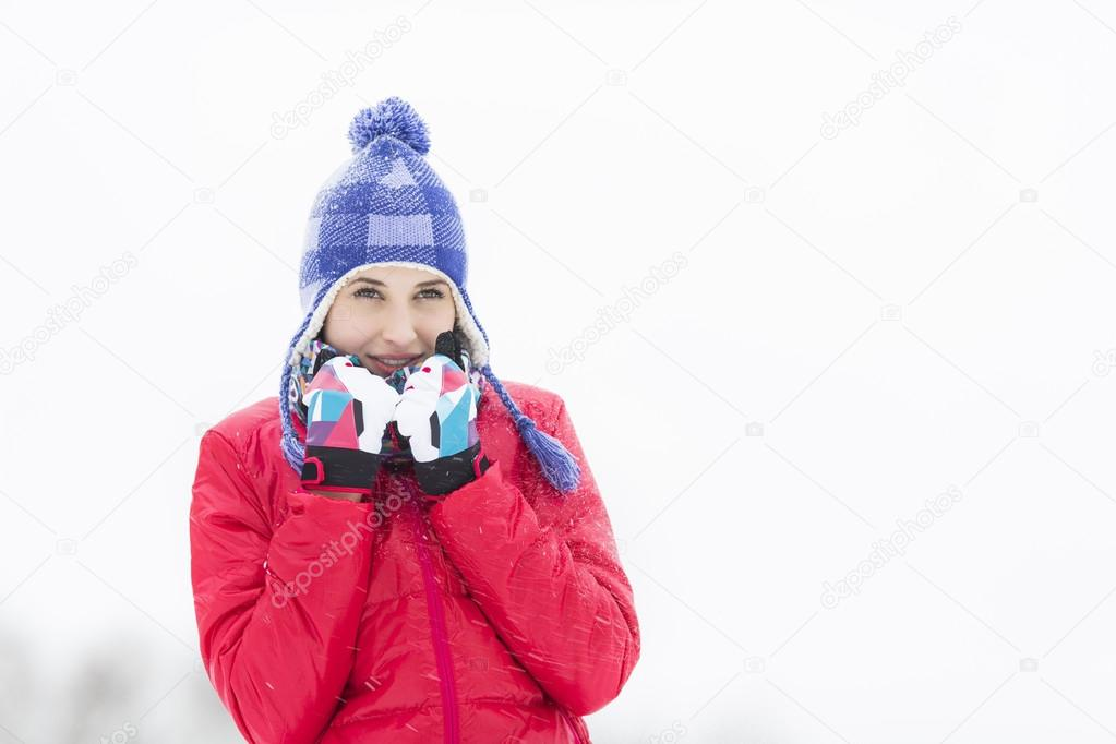 woman in warm clothing walking outdoors