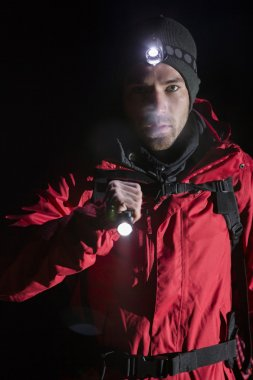 Hiker with flashlight