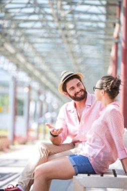 man talking to woman