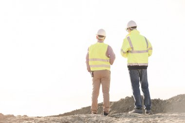 architects standing at construction site