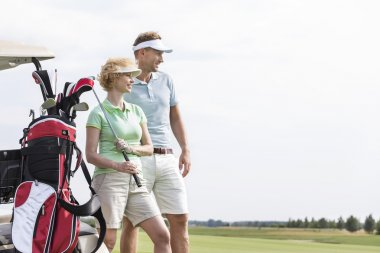 woman standing at golf course