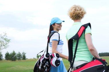 golfer talking to friend