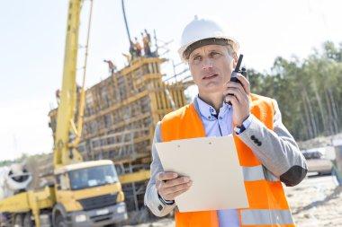 Supervisor using walkie-talkie