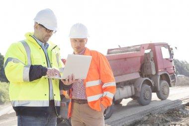 Engineers using laptop