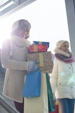 women with gifts and shopping bags