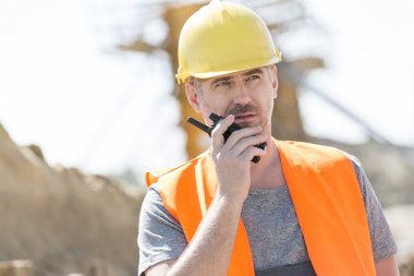 supervisor using walkie-talkie